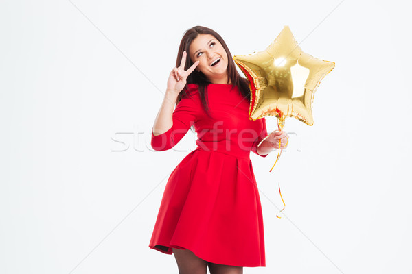 Woman holding balloon and showing two fingers sign Stock photo © deandrobot