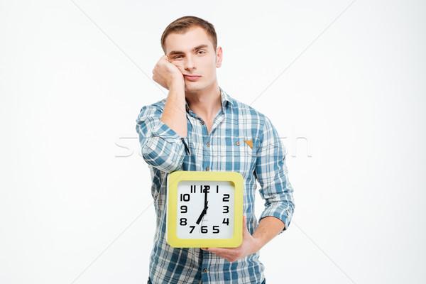 печально скучно молодым человеком большой часы Сток-фото © deandrobot