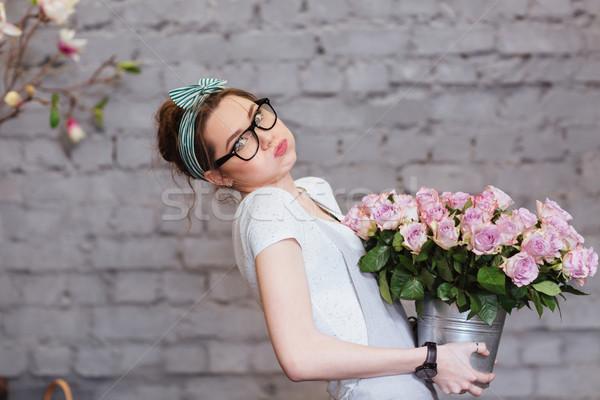 Cute zmęczony młoda kobieta ciężki wiadro Zdjęcia stock © deandrobot