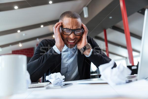 Kimerült üzletember munka iroda papír férfi Stock fotó © deandrobot