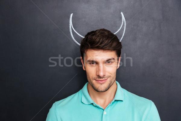 Közelkép jóképű fiatalember rajzolt ördög agancs Stock fotó © deandrobot