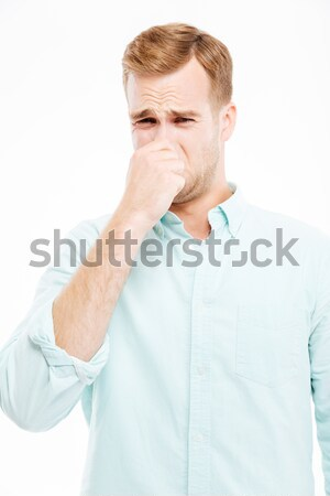 Unhappy businessman closed nose by hand and feeling bad smell Stock photo © deandrobot