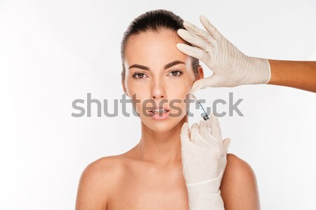 Beauty portrait of happy young woman touching her hair Stock photo © deandrobot