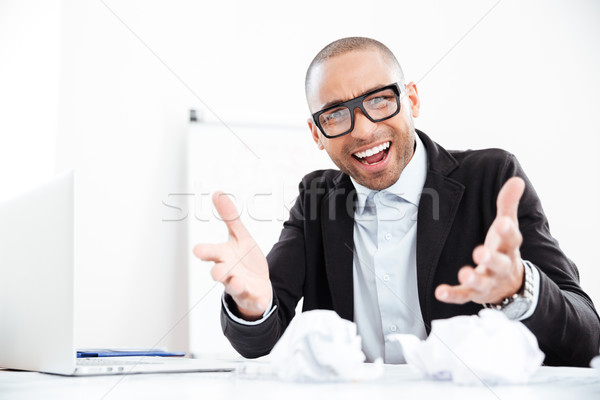 Angry stressed businessman shouting at camera Stock photo © deandrobot