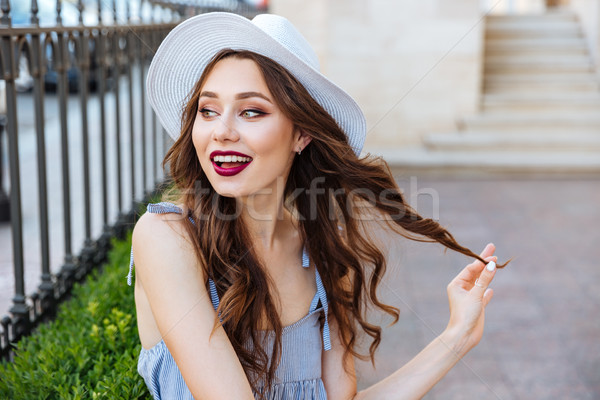 Close up portrait of a smiling beautiful girl posing outdoors Stock photo © deandrobot