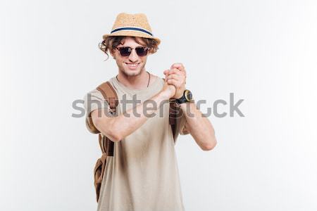 Young smiling stylish man showing well done gesture Stock photo © deandrobot