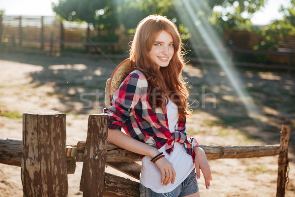 Happy woman cowgirl standing and relaxing on ranch Stock photo © deandrobot