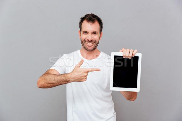Przystojny mężczyzna wskazując palec ekranu portret Zdjęcia stock © deandrobot