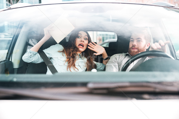 Afraid couple in car Stock photo © deandrobot