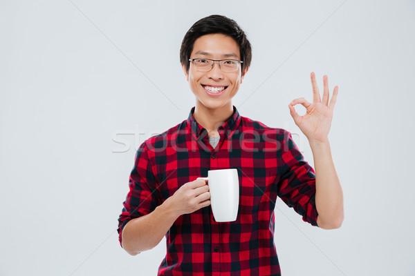 Homem copo chá Foto stock © deandrobot
