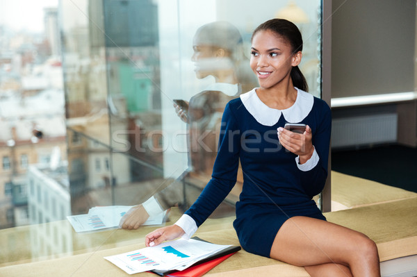 Stock photo: Afro Business woman near the window