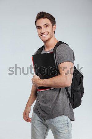 Retrato sorridente masculino estudante mochila Foto stock © deandrobot