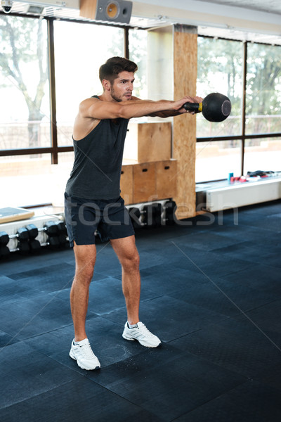 Fitness man holdint the weight Stock photo © deandrobot