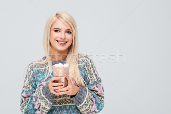 Pretty model in sweater with coffee Stock photo © deandrobot