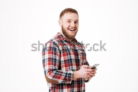 бородатый человека рубашку позируют оружия студию Сток-фото © deandrobot