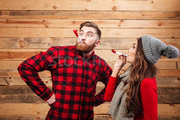 Couple in warm clothes Stock photo © deandrobot