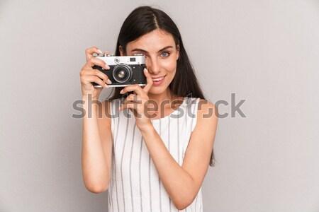 Portret młoda kobieta Fotografia retro kamery Zdjęcia stock © deandrobot