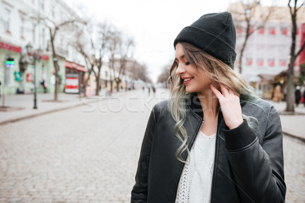 Amazing young lady wearing hat walking on the street Stock photo © deandrobot
