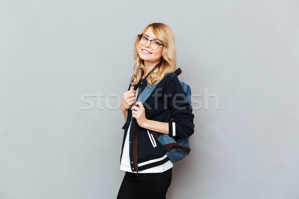Pretty young lady student wearing glasses with backpack Stock photo © deandrobot