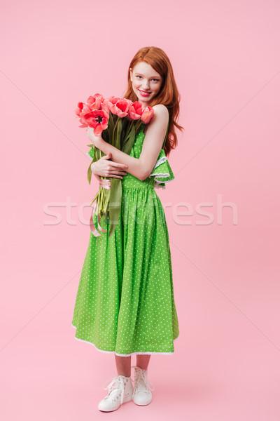 Teljes alakos kép gyömbér nő tart virágcsokor Stock fotó © deandrobot