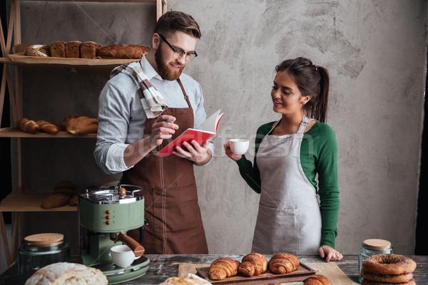 Alegre amoroso casal potável café olhando Foto stock © deandrobot