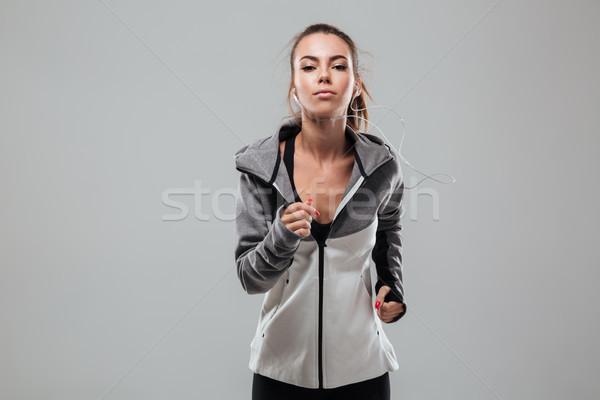 Ernstig vrouwelijke runner warm kleding lopen Stockfoto © deandrobot