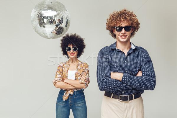 Mosolyog retro szerető pár diszkógömb fotó Stock fotó © deandrobot