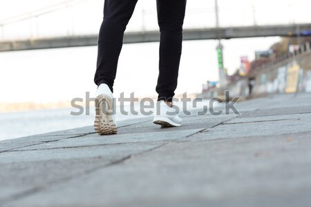 Cropped image of a young teenage skateboarder in action Stock photo © deandrobot