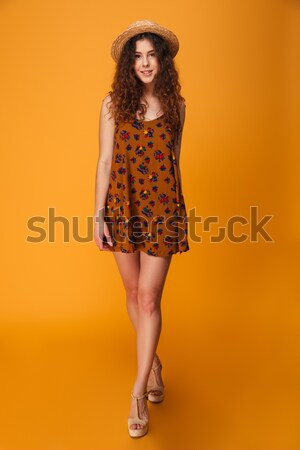 Full-length portrait of charming young girl in red dress touchin Stock photo © deandrobot