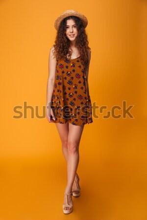 Portret młoda dziewczyna czerwona sukienka dotknąć włosy Zdjęcia stock © deandrobot