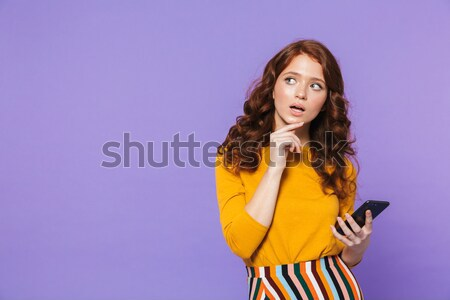 Young attractive teenage girl holding book Stock photo © deandrobot