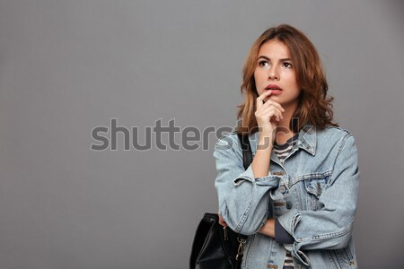 Close-up portrait of pretty brunette woman in casual wear showin Stock photo © deandrobot