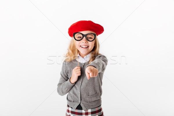 портрет счастливым мало школьница равномерный указывая Сток-фото © deandrobot