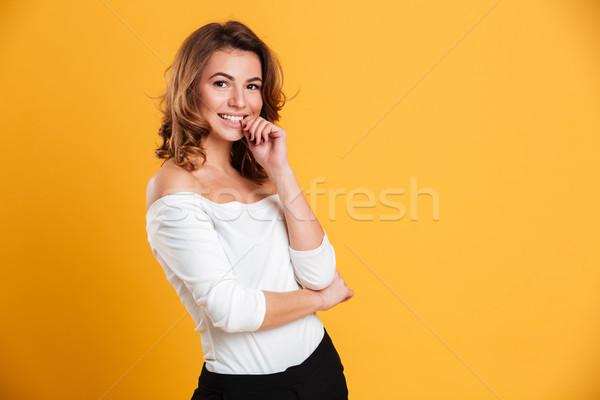 Podniecony szczęśliwy młoda kobieta Fotografia stałego odizolowany Zdjęcia stock © deandrobot