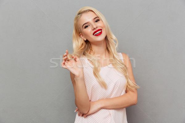 Portré gyönyörű nő flörtöl néz kamera izolált Stock fotó © deandrobot