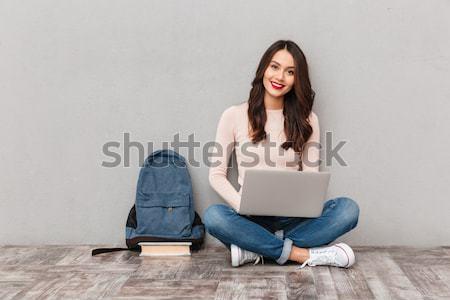 快樂 女子 毛線衣 坐在 地板 商業照片 © deandrobot