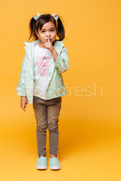 Cute petite fille enfant silence geste Photo stock © deandrobot