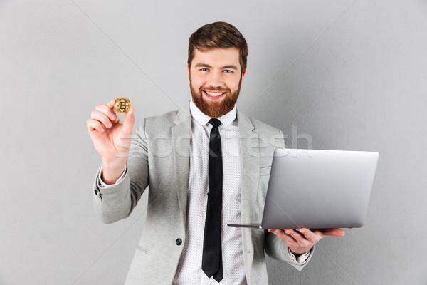 Portrait affaires bitcoin ordinateur portable Photo stock © deandrobot