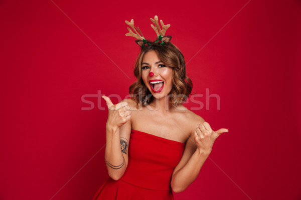 Portrait of a joyful happy girl wearing christmas deer costume Stock photo © deandrobot