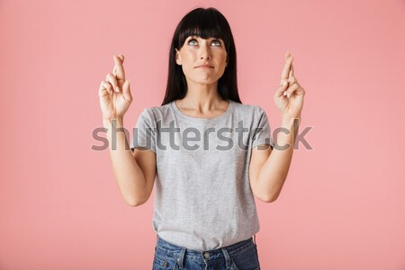 Portrait of serious asian woman standing with outstretched hand  Stock photo © deandrobot