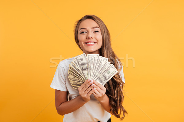 Portrait of a happy satisfied girl Stock photo © deandrobot