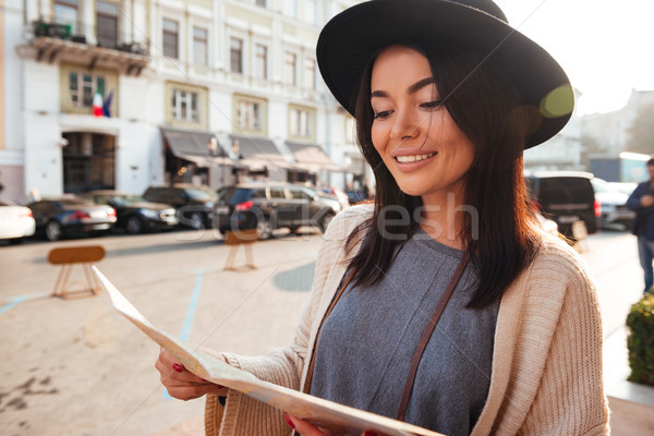 Close up portrait of a lovely young woman tourist Stock photo © deandrobot