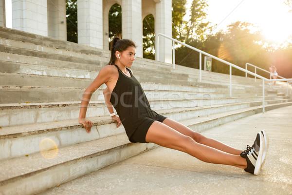 Portre motive fitness woman kulaklık spor merdiven Stok fotoğraf © deandrobot