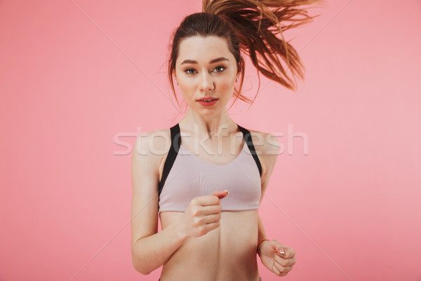 Concentrated young fitness sports woman Stock photo © deandrobot