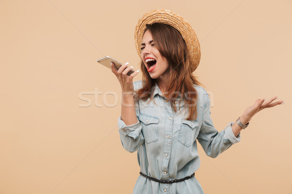 Portrait of a furious young girl in summer clothes yelling Stock photo © deandrobot