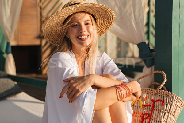 Laughing young girl in summer hat and swimwear Stock photo © deandrobot