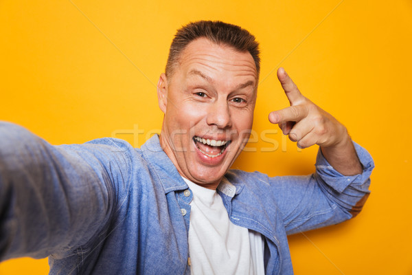 Portrait of a happy middle aged man Stock photo © deandrobot