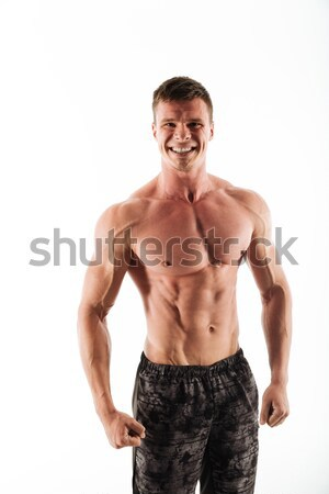 Stock photo: Smiling muscular man holding salad over white background
