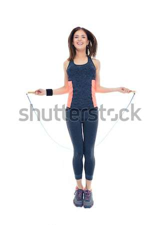 Full-length portrait of a young smiling businesswoman standing with arms crossed isolated on a white Stock photo © deandrobot