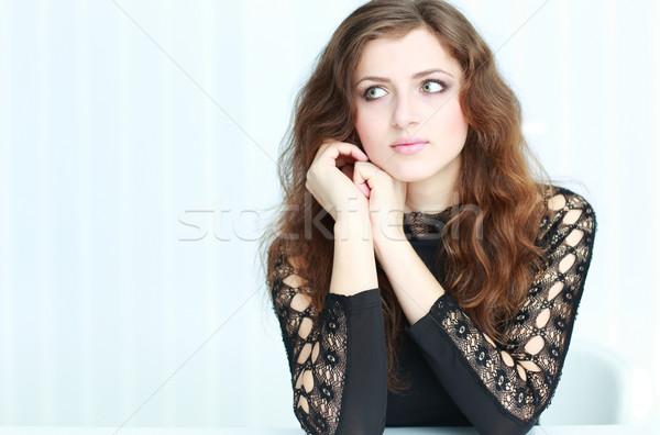 Figyelmes fiatal nő ül asztal oldal copy space Stock fotó © deandrobot